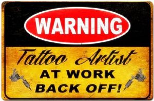 Warning Tattoo Artist At Work rusted metal sign 450mm x 300mm (pst 1812)